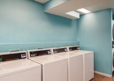 Laundry services at the Villa Serrano Apartments with blue wall