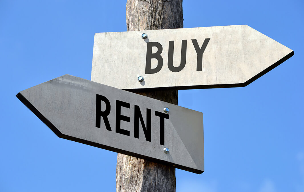 Signposts that say buy and rent
